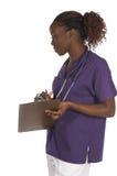 Krankenschwester mit einem Klemmbrett Lizenzfreie Stockbilder