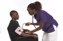 Krankenschwester und Patient Stockbild