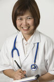 Krankenschwesterschreiben Stockbild