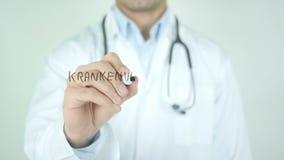 Krankenversicherung, Health Insurance in German Writing on Glass. Man writing stock video footage