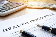 Krankenversicherungsform in der Agentur Stockfoto