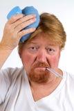 Kranker Mann mit Grippe Stockfotos