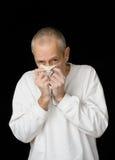 Kranker Mann mit kaltem haltenem Taschentuch Lizenzfreies Stockbild