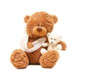 Kranker Teddybär mit ihrem Schätzchen Lizenzfreies Stockfoto