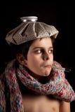 Krankes Kind mit Thermometer und Eisbeutel Lizenzfreies Stockbild