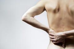 Krankheit der Rückseite und des Kerls gehalten Stockfotografie
