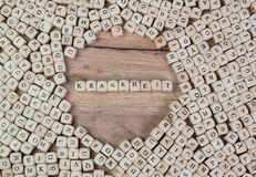 Krankheit, German text for illness, word in letters on cube dices on table stock photo