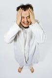 Krankzinnige mens in dwangbuis Stock Afbeeldingen