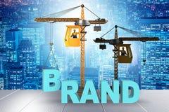 Kranlyftande märkesbokstäverna på kommersiellt begrepp stock illustrationer
