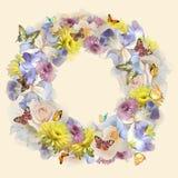 Krans av blommor och fjärilar Arkivfoto