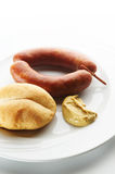 Kransky sausage with bread and mustard Royalty Free Stock Image