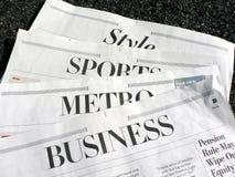 Krant - krantensecties Stock Foto's