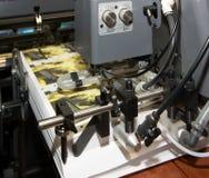 Kranten bij compensatie afgedrukte machine Stock Afbeelding