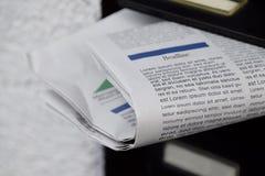 Kranten in een brievenbus royalty-vrije stock afbeelding