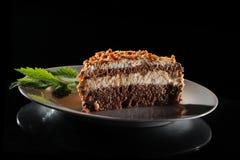 Krantz cake. A krantz cake on white plate on black background stock images