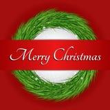 Kranz mit Text der frohen Weihnachten stockfotografie