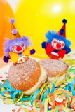 Krapfen or Donuts with clowns and streamer Royalty Free Stock Photography