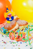 Krapfen or Donuts with clowns and streamer Royalty Free Stock Image