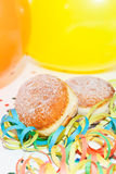 Krapfen or Donuts with streamer and balloons Royalty Free Stock Image