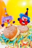 Krapfen ou butées toriques avec les clowns et la flamme Photographie stock libre de droits