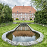 Krapperup Castle and Pond. Krapperup's Castle is one of the oldest and most impressive manor buildings in Scania Royalty Free Stock Photos