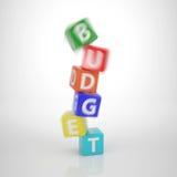 Krascha det budget- tornet - serieord ut ur bokstav tärnar Arkivbild