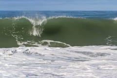 krascha waves för strand Arkivfoto