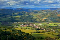 Krasnany town from Mala Fatra mountain. FView of the evening village from the mountains in Slovakia. Mountain forest with storm cl. Krasnany town from Mala Fatra Stock Photos