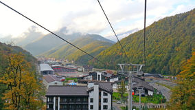 Krasnaya Polyana from the height, mountains and clouds, autumn landscape Royalty Free Stock Photos