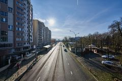 Krasnodar - Kubanskaya naberezhnaya. Cityscape at the beginning of winter. Roads, buildings, cars, infrastructure, sunny weather. stock photography