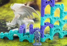 Krasnodar, Russia - July 25, 2018: Playing board game `Elven Castle`; plastic figure of dragon standing near elven castle on a map. Editorial stock photos