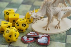 Krasnodar, Russia, July 19, 2018: Playing Dungeons and Dragons. Dices, tiled map, indicatos of health in the form of hearts, drago. Krasnodar, Russia, July 19 stock images