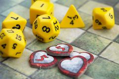 Krasnodar, Russia, July 19, 2018: Playing Dungeons and Dragons. Dices, tiled map, indicatos of health in the form of heartsr. Krasnodar, Russia, July 19, 2018 stock photo