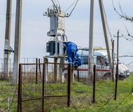 Electricians repair electrical transformer. Repair team on the road stock photography