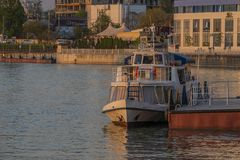 Krasnodar, Russia, May 5, 2019. Kuban river in the evening in Krasnodar, Pier and river tram on the water. View of the waterfront stock image