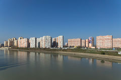 KRASNODAR, RUSSIA - NOVEMBER 03.2013: Buildings at the river Stock Image