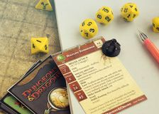 Krasnodar, Russia, 14 September 2018: Playing Dungeons and dragons rpg game: dices, character cards, map. Board, tabletop or role playing games. Fantasy stock photo