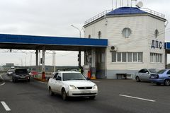 Post road police patrol on the federal highway `Don` in the Krasnodar Territory. KRASNODAR, RUSSIA - SEPTEMBER 13, 2014:Post road police patrol on the federal royalty free stock image