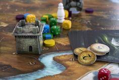 Krasnodar/Russian Federation – JUNE 10, 2018: Playing Legends of Andor board game; dices, figures and tiles, map. Krasnodar/Russian Federation – stock photography