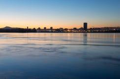 Krasnoyarsk city on the Yenisei, sunset. Krasnoyarsk quay, cityscape, sunset, Yenisei, lights reflected in the water Royalty Free Stock Photo