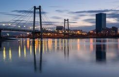 Krasnoyarsk, a pedestrian bridge over the Yenisei. Night city Krasnoyarsk, a pedestrian bridge over the Yenisei Royalty Free Stock Photos