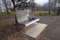 Memorial bench dedicated to all the dead rock musicians in central park of Krasnoyarsk. Krasnoyarsk, Krasnoyarsk Region / RF - October 30, 2018: Memorial bench royalty free stock photo
