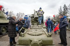 Children play on the antiaircraft, which stand near the museum of the Victory Memorial during the celebration of Victory Day WWII. KRASNOYARSK, RF - May 9, 2018 stock photo