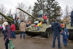 Children play on the tank and big guns, which stand near the museum of the Victory Memorial during the celebration of Victory Day. KRASNOYARSK, RF - May 9, 2018 stock image