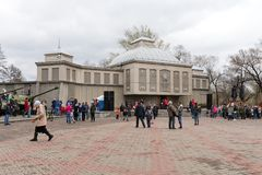 People came on the square in front of building museum of the Victory Memorial during the celebration of Victory Day WWII. KRASNOYARSK, RF - May 9, 2018: People stock photography