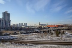 Districts of the town overlooking the shopping and entertainment center and the road to traffic. KRASNOYARSK, RF - November:District `North` of the city Stock Photo