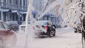 KRASNOYARSK/RUSSIA-2018 January 25 : car traffic in winter day in the city centre. Car traffic in city at winter day stock footage
