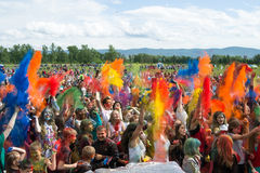 KRASNOYARSK, RUSSIA - JUNE 2015: People celebrate Holi-like part of festival Green. All participants simultaneously thrown in the air colored powders Stock Photo