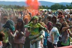 KRASNOYARSK, RUSSIA - JUNE 2015: People celebrate Holi-like part of festival Green. Baby taking part in festival. KRASNOYARSK, RUSSIA - JUNE 2015: People Stock Images