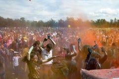 KRASNOYARSK, RUSSIA - JUNE 2015: People celebrate Holi-like part of festival Green. People dancing after powder buttle. KRASNOYARSK, RUSSIA - JUNE 2015: People Royalty Free Stock Images